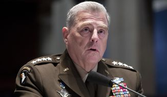 In this July 9, 2020, file photo, Chairman of the Joint Chiefs of Staff Gen. Mark Milley testifies during a House Armed Services Committee hearing on Capitol Hill in Washington. The nation's top military leaders were under self-quarantine Tuesday, Oct. 6, after a senior Coast Guard official tested positive for the coronavirus, the Pentagon said. Milley, and the vice chairman, Gen. John Hyten, were among those affected, U.S. officials said. (Michael Reynolds/Pool via AP, File)