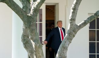 President Trump is shown here in a Sept. 30, 2020 file photo walking out of the Oval Office. (Associated Press)  **FILE**
