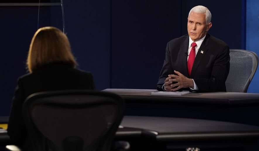 Vice President Mike Pence answer a question from moderator Susan Page, Washington Bureau Chief for USA Today, during the vice presidential debate with Democratic vice presidential candidate Sen. Kamala Harris, D-Calif., Wednesday, Oct. 7, 2020, at Kingsbury Hall on the campus of the University of Utah in Salt Lake City. (AP Photo/Patrick Semansky)
