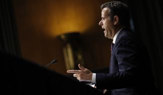 In this May 5, 2020, file photo then-Rep. John Ratcliffe, R-Texas, testifies before a Senate Intelligence Committee nomination hearing on Capitol Hill in Washington. Ratcliffe, the director of national intelligence, has been working to declassify details about the Russia investigation, which culminated in the 2019 report by former special counsel Robert Mueller. (AP Photo/Andrew Harnik, Pool, File)