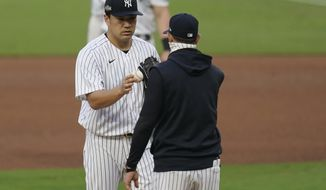 New York Yankees manager Aaron Boone, right, pulls starting pitcher Masahiro Tanaka during the fifth inning in Game 3 of a baseball American League Division Series, Wednesday, Oct. 7, 2020, in San Diego. (AP Photo/Gregory Bull)