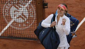 Sofia Kenin of the U.S. celebrates winning her quarterfinal match of the French Open tennis tournament against Danielle Collins of the U.S. in three sets 6-4, 4-6, 6-0, at the Roland Garros stadium in Paris, France, Wednesday, Oct. 7, 2020. (AP Photo/Alessandra Tarantino)