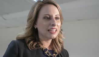 "FILE - In this April 3, 2019, file photo, Rep. Katie Hill, D-Calif., talks on Capitol Hill in Washington. The former US House Twitter account of ex-Rep. Hill was hacked Wednesday, Oct. 7, 2020, purportedly by ""former staff"" who criticized a planned movie about her life and accused Hill of workplace abuse. (AP Photo/J. Scott Applewhite, File)"