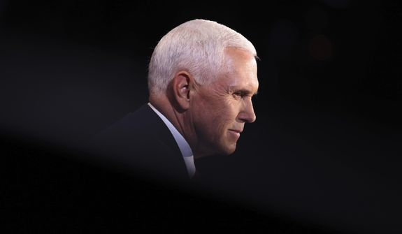 Vice President Mike Pence listens during the vice presidential debate Wednesday, Oct. 7, 2020, at Kingsbury Hall on the campus of the University of Utah in Salt Lake City. (Justin Sullivan/Pool via AP) ** FILE **