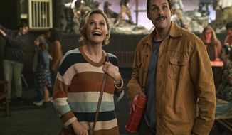 "This image released by Netflix shows Julie Bowen, left, and Adam Sandler in a scene from ""Hubie Halloween."" (Scott Yamano/Netflix via AP)"