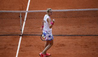Petra Kvitova of the Czech Republic clenches her fist after scoring a point against Germany's Laura Siegemund in the quarterfinal match of the French Open tennis tournament at the Roland Garros stadium in Paris, France, Wednesday, Oct. 7, 2020. (AP Photo/Christophe Ena)