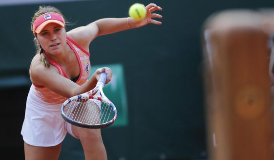 Sofia Kenin of the U.S. plays a shot against Danielle Collins of the U.S. in the quarterfinal match of the French Open tennis tournament at the Roland Garros stadium in Paris, France, Wednesday, Oct. 7, 2020. (AP Photo/Christophe Ena)