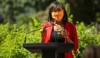 Zena Howard, principal and managing director of the architecture firm Perkins+Will, speaks during a ground breaking ceremony for the new North Carolina Freedom Park, located between the North Carolina State Legislative Building and the Governor's Mansion, and designed by the late architect Phil Freelon, on Wednesday, Oct. 7, 2020, in Raleigh, N.C. (Casey Toth/The News & Observer via AP)