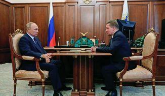 Russian President Vladimir Putin, left, listens to Russian gas monopoly Gazprom Head, Alexei Miller during their meeting in Moscow, Russia, Wednesday, Sept. 16, 2020. (Mikhail Klimentyev, Sputnik, Kremlin Pool Photo via AP)