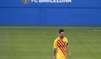Barcelona's Lionel Messi leaves the field at half time during the pre-season friendly soccer match between Barcelona and Gimnastic at the Johan Cruyff Stadium in Barcelona, Spain, Saturday, Sept.12, 2020. (AP Photo/Joan Monfort)