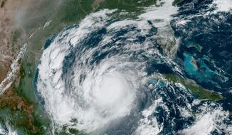 This Wednesday, Oct. 7, 2020 satellite image made available by National Oceanic and Atmospheric Administration shows Hurricane Delta in the Gulf of Mexico at 10:41 a.m. EDT. Delta made landfall Wednesday just south of the Mexican resort of Cancun as an extremely dangerous Category 2 storm. (NOAA via AP)