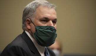 Internal Revenue Service Commissioner Charles Rettig prepares to testify before a House Committee on Oversight and Reform hearing on Wednesday, Oct. 7, 2020, in Washington. (Tasos Katopodis/Pool via AP)