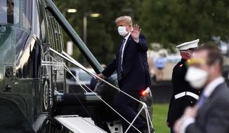 FILE - In this Oct. 5, 2020, file photo, President Donald Trump boards Marine One at Walter Reed National Military Medical Center after receiving treatment for coronavirus in Bethesda, Md. Ethics experts say the special treatment Trump received to access an experimental COVID-19 drug raises fairness issues and the public's right to know more about Trump's condition. (AP Photo/Evan Vucci, File)