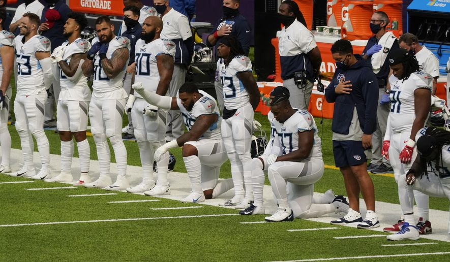 In this Sept. 27, 2020, file photo, members of the Tennessee Titans take part in the national anthem before an NFL football game against the Minnesota Vikings, in Minneapolis.  Tennessee will not be returning to the team's facility Wednesday, Oct. 7, 2020, after two more players tested positive in the NFL's first COVID-19 outbreak, a person familiar with the situation told The Associated Press. The Titans had no positive tests Monday or Tuesday for the first time after six consecutive days of positive results. A third straight day was necessary for the team to be allowed back in its headquarters.(AP Photo/Jim Mone)  **FILE**