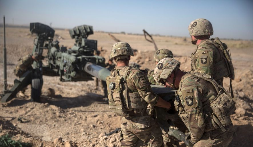 In this June 10, 2017, photo provided by Operation Resolute Support, U.S. soldiers with Task Force Iron maneuver an M-777 howitzer, so it can be towed into position at Bost Airfield, Afghanistan. (Associated Press) **FILE**