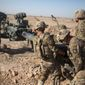 In this June 10, 2017, photo provided by Operation Resolute Support, U.S. soldiers with Task Force Iron maneuver an M-777 howitzer, so it can be towed into position at Bost Airfield, Afghanistan. (Associated Press) ** FILE **