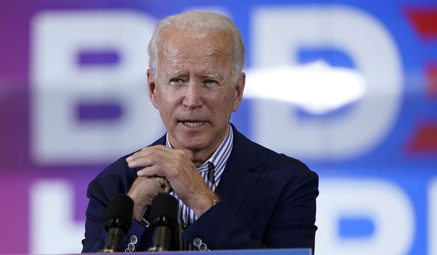 Democratic presidential candidate former Vice President Joe Biden speaks at the Carpenters Local Union 1912 in Phoenix, Thursday, Oct. 8, 2020, to kick off a small business bus tour. (AP Photo/Carolyn Kaster)