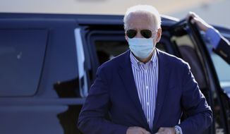 Democratic presidential candidate former Vice President Joe Biden walks to board his campaign plane at New Castle Airport in New Castle, Del., Thursday, Oct. 8, 2020., en route to Arizona. (AP Photo/Carolyn Kaster)