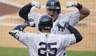 New York Yankees' Luke Voit, right, celebrates with Gleyber Torres (25) after Voit hit a solo home run against the Tampa Bay Rays during the second inning in Game 4 of a baseball American League Division Series against the Tampa Bay Rays, Thursday, Oct. 8, 2020, in San Diego. (AP Photo/Gregory Bull)