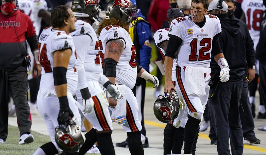 Tampa Bay Buccaneers quarterback Tom Brady (12) yells at members of his offensive line as they walk off the field during the second half of an NFL football game against the Chicago Bears in Chicago, Thursday, Oct. 8, 2020. (AP Photo/Charles Rex Arbogast)