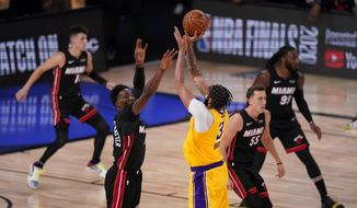 Los Angeles Lakers forward Anthony Davis makes a 3-point basket with 40 seconds left on the clock in Game 4 of basketball's NBA Finals against the Miami Heat Tuesday, Oct. 6, 2020, in Lake Buena Vista, Fla. (AP Photo/Mark J. Terrill)  **FILE**