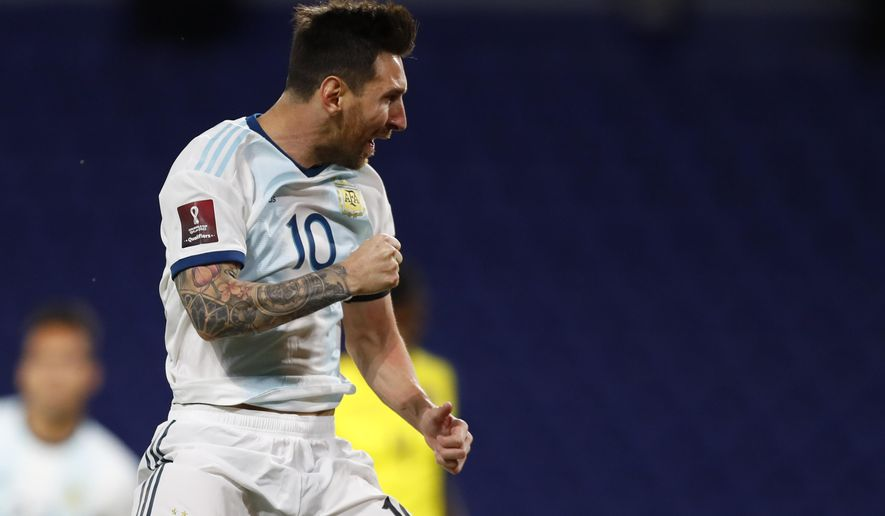 Argentina's Lionel Messi celebrates scoring his side's first goal during a qualifying soccer match against Ecuador for the FIFA World Cup Qatar 2022 at the Bombonera stadium in Buenos Aires, Argentina, Thursday, Oct. 8, 2020.(Agustin Marcarian/Pool via AP)