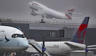 Aircraft G-CIVY, one of the last two British Airways Boeing 747-400 aircraft takes off for its last flight departure from London's Heathrow Airport, Thursday, Oct. 8, 2020. The retirement of the fleet was brought forward as a result of the impact the Covid-19 pandemic had on the airline and the aviation sector. ( Steve Parsons/PA via AP)