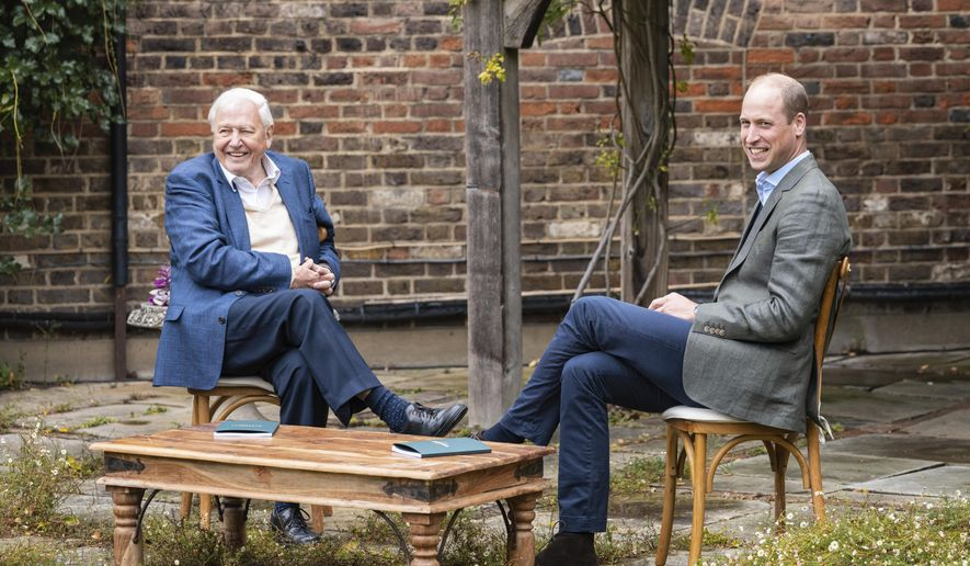 In this undated photo provided by Kensington Palace on Wednesday, Oct. 7, 2020, Britain's Prince William, right and Naturalist Sir David Attenborough react as they disicuss the Earthshot Prize at Kensington Palace, in London. Prince William has launched the most prestigious global environment prize in history to tackle climate issues. (Kensington Palace via AP)