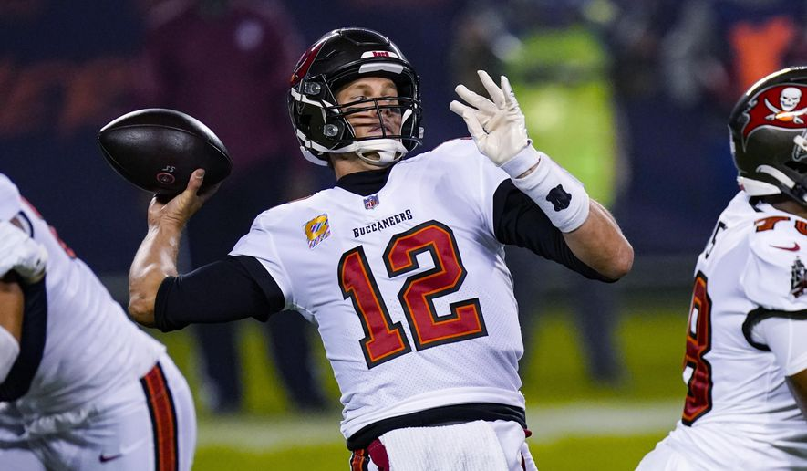Tampa Bay Buccaneers quarterback Tom Brady (12) throws a pass against the Chicago Bears during the first half of an NFL football game in Chicago, Thursday, Oct. 8, 2020. (AP Photo/Charles Rex Arbogast)