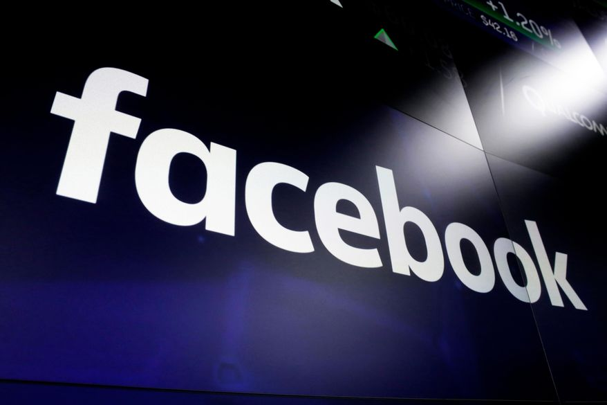 In this March 29, 2018, file photo, is the logo for social media giant Facebook at the Nasdaq MarketSite in New York's Times Square. (AP Photo/Richard Drew, File)