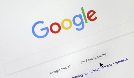 In this Aug. 28, 2018, file photo, a cursor moves over Google's search engine page, in Portland, Ore. (AP Photo/Don Ryan, File)