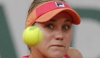 Sofia Kenin of the U.S. plays a shot against Petra Kvitova of the Czech Republic in the semifinal match of the French Open tennis tournament at the Roland Garros stadium in Paris, France, Thursday, Oct. 8, 2020. (AP Photo/Michel Euler)