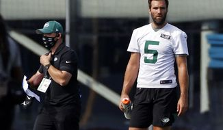 FILE - In this Saturday, Aug. 22, 2020, file photo, New York Jets quarterback Joe Flacco (5) pauses during practice at the NFL football team's training camp in Florham Park, N.J. Flacco is preparing this week to start against the Arizona Cardinals after a sprained shoulder sidelined Sam Darnold for at least a game. (AP Photo/Adam Hunger, File)