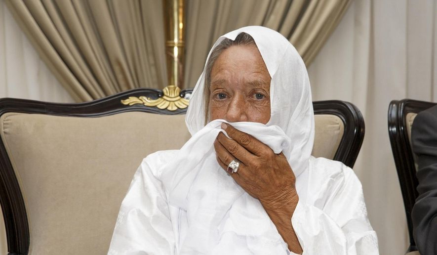 In this photo provided by the Mali Presidency, French ex-hostage Sophie Petronin is seen at the presidential palace after being released and flown to the capital Bamako, Mali, late Thursday, Oct. 8, 2020. A prominent Malian politician and three European hostages freed by Islamic extremists in northern Mali this week landed in the country's capital late Thursday where they held emotional reunions with family members and were greeted by government officials. (Mali Presidency via AP)