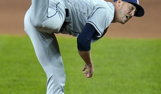 Tampa Bay Rays relief pitcher Oliver Drake follows through on a pitch to the Baltimore Orioles during the sixth inning of a baseball game, Friday, Sept. 18, 2020, in Baltimore. (AP Photo/Julio Cortez)