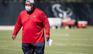 Houston Texans interim head coach Romeo Crennel watches his players warm up during his first practice leading the team Wednesday, Oct. 7, 2020, at The Houston Methodist Training Center in Houston. Crennel takes over for fired Houston head coach Bill O'Brien, who was fired this week after an 0-4 start to the 2020 season./Houston Chronicle via AP)