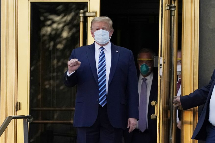 President Donald Trump walks out of Walter Reed National Military Medical Center to return to the White House after receiving treatments for COVID-19, Monday, Oct. 5, 2020, in Bethesda, Md. (AP Photo/Evan Vucci) **FILE**
