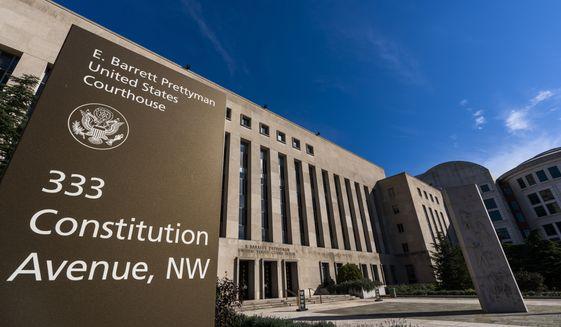 The E. Barrett Prettyman United States Court House is seen, Friday, Oct. 9, 2020, in Washington, D.C.. (AP Photo/Manuel Balce Ceneta)  **FILE**