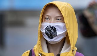 Swedish climate activist Greta Thunberg attends a Fridays For Future protest outside the Swedish Parliament, in Stockholm, Sweden, Friday, Oct. 9, 2020.  (Jessica Gow/TT via AP)  **FILE**