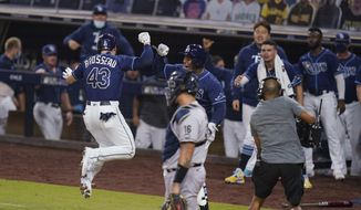 Tampa Bay Rays' Michael Brosseau (43) celebrates after hitting a solo home run during the eighth inning in Game 5 of the baseball team's AL Division Series against the New York Yankees, Friday, Oct. 9, 2020, in San Diego. (AP Photo/Gregory Bull)