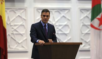 Spanish Prime Minister Pedro Sanchez, delivers his speech as he attends a meeting with Spanish and Algerian business representatives, Thursday, Oct.8, 2020 in Algiers. (AP Photo/Anis Belghoul)