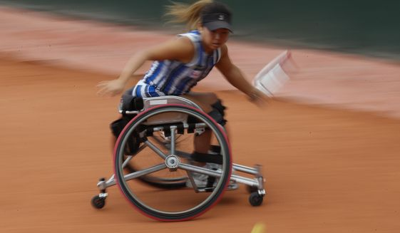 Japan's Yui Kamiji plays a shot against Japan's Momoko Ohtani in the women's wheelchair final match of the French Open tennis tournament at the Roland Garros stadium in Paris, France, Friday, Oct. 9, 2020. (AP Photo/Alessandra Tarantino)