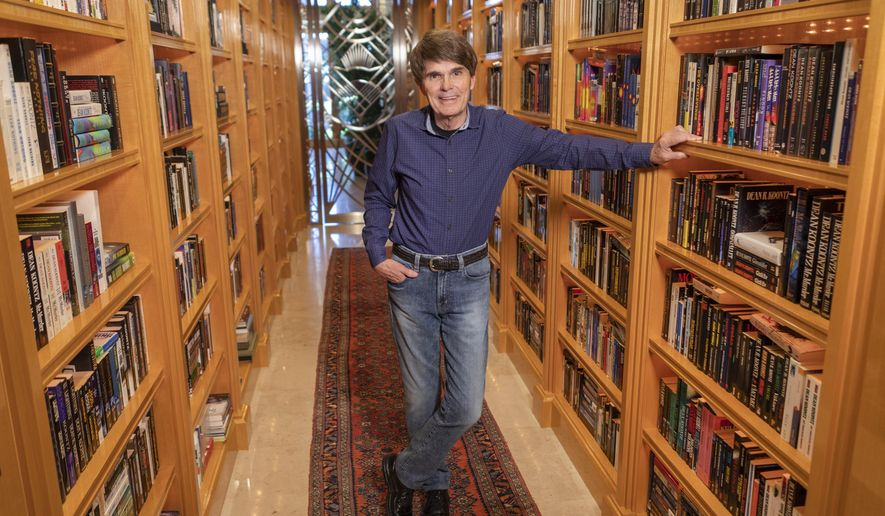 """This image released by Thomas & Mercer shows author Dean Koontz, who is out with his 78th book called """"Elsewhere,"""" about a father and his young daughter who get the ability to time hop to parallel universes. (Douglas Sonders/Thomas & Mercer via AP)"""