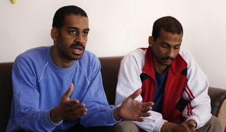 "FILE - In this March 30, 2019, file photo, Alexanda Amon Kotey, left, and El Shafee Elsheikh, who were allegedly among four British jihadis who made up a brutal Islamic State cell dubbed ""The Beatles,"" speak during an interview with The Associated Press at a security center in Kobani, Syria.   The Justice Department is preparing to announce charges Wednesday against two men from Britain who joined the Islamic State and were part of a cell that beheaded Western hostages, a law enforcement official said.  Their arrival in the U.S. to face charges sets the stage for arguably the most sensational terrorism prosecution since the 2014 case against the suspected ringleader of a deadly attack on the diplomatic compound in Benghazi, Libya.(AP Photo/Hussein Malla, File)"