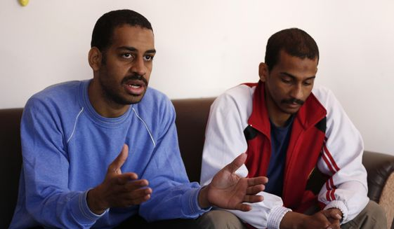 """FILE - In this March 30, 2019, file photo, Alexanda Amon Kotey, left, and El Shafee Elsheikh, who were allegedly among four British jihadis who made up a brutal Islamic State cell dubbed """"The Beatles,"""" speak during an interview with The Associated Press at a security center in Kobani, Syria.   The Justice Department is preparing to announce charges Wednesday against two men from Britain who joined the Islamic State and were part of a cell that beheaded Western hostages, a law enforcement official said.  Their arrival in the U.S. to face charges sets the stage for arguably the most sensational terrorism prosecution since the 2014 case against the suspected ringleader of a deadly attack on the diplomatic compound in Benghazi, Libya.(AP Photo/Hussein Malla, File)"""