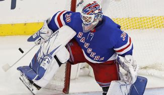 FILE - In this Dec. 27, 2019, file photo, New York Rangers goaltender Henrik Lundqvist makes a save during the third period of the team's NHL hockey against the Carolina Hurricanes in New York. Lundqvist signed with the Washington Capitals when free agency opened Friday, Oct. 9, 2020.  (AP Photo/Kathy Willens, File)  **FILE**