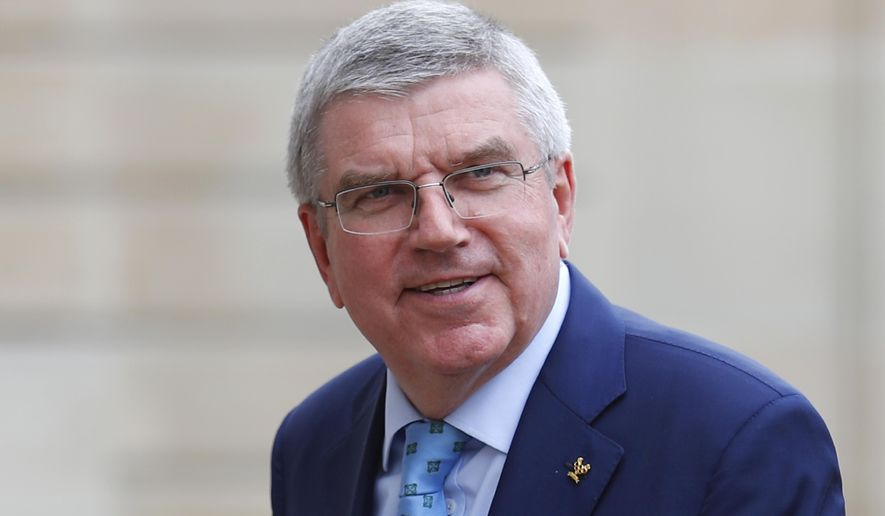 FILE - In this June 7, 2019, file photo, International Olympic Committee (IOC) President Thomas Bach arrives to meet French President Emmanuel Macron at the Elysee Palace in Paris. Bach is planning a trip to Japan November, 2020, to meet with new Prime Minister Yoshihide Suga and organizers of the postponed Tokyo Olympics, Tokyo Olympic CEO Toshiro Muto said Friday, Oct. 9. (AP Photo/Francois Mori, File)