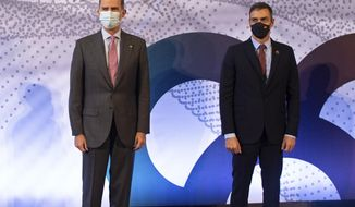 Spain's King Felipe VI and Prime Minister Pedro Sanchez, right, pose together while attending the Barcelona New Economy Week business awards in Barcelona, Spain, Friday Oct. 9, 2020. Several thousand Catalan separatists nearby are protesting the visit of Spanish King Felipe VI and Prime Minister Pedro Sanchez to Barcelona amid continued tensions between the restive region and national authorities. (David Zorrakino/Europa Press via AP)