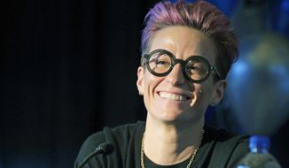 In this Dec. 19, 2019, file photo, Megan Rapinoe, a forward with OL Reign and the U.S. women's national team, attends a news conference in Tacoma, Wash. Rapinoe is among the athletes touting the benefits of CBD for pain management and recovery. CBD products have become big business after the 2018 Farm Bill made hemp a legal agricultural crop. CBD is found in both hemp and marijuana plants. It has been hailed as a health and wellness aid and infused in everything from gummies to lotions. Rapinoe's twin sister Rachael has helped launch a CBD products company called Mendi, which is geared toward athletes. (AP Photo/Ted S. Warren, File)