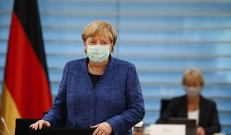 German Chancellor Angela Merkel attends the weekly cabinet meeting of the German government at the chancellery in Berlin, Germany, Wednesday, Oct. 7, 2020. (AP Photo/Markus Schreiber, Pool)